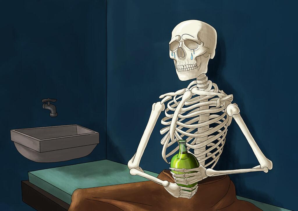 Sad skeleton in a prison cell